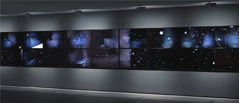 U Becomes Snow, Digital print, 20 Pieces, 57.6 x 90cm (each), 1998. / The artist spent a midwinter night walking along the stairs of an apartment photographing snowflakes in the night sky. With the snowflakes appearing comparatively huge next to the tiny urban buildings, the photograph encourages us to adopt a unique perspective on ordinary snow.