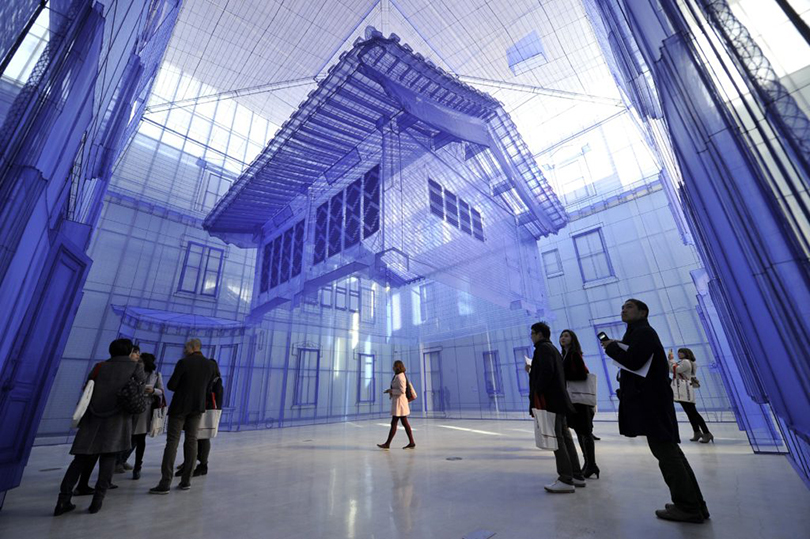 Visitors look at Do Ho Suh's site-specific work